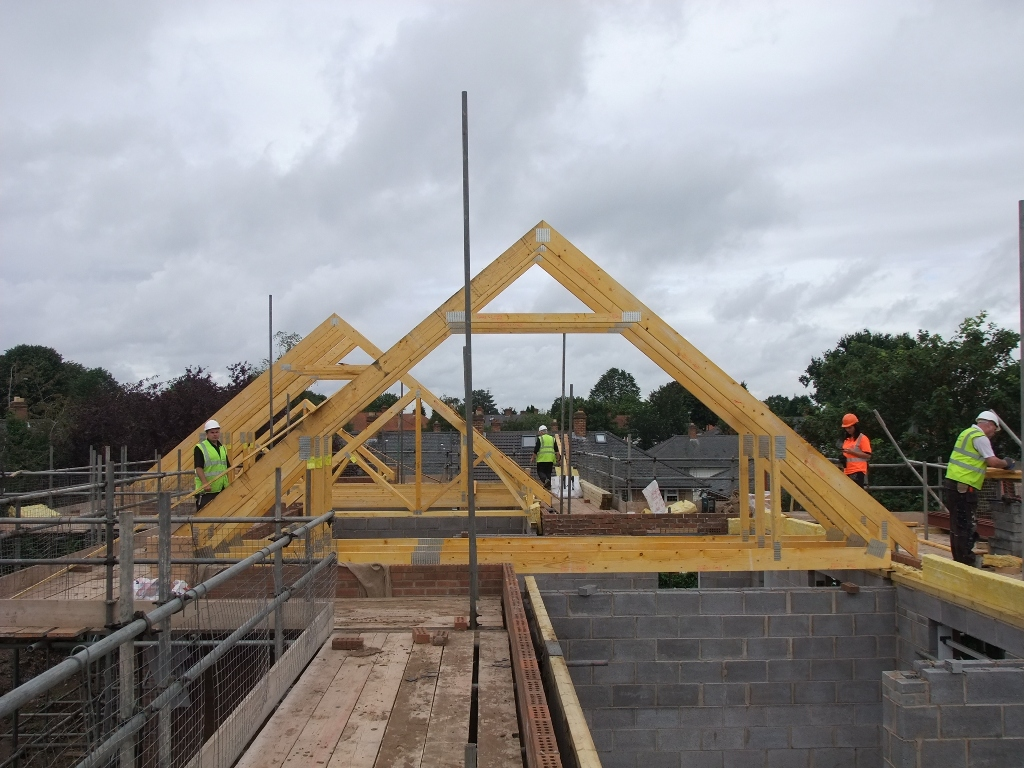 roof trusses being craned in on the 5 new homes we 39 re