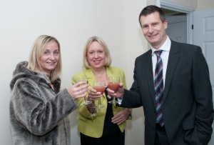 Lorely Burt MP & Andy Evans raise a toast to Angela the buyer of Plot 5