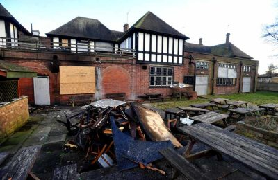 The fire-ravaged exterior and garden of the Bushbury Arms in 2013